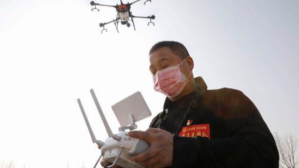 surveillance-drones.China-CNN-facemasked-operator